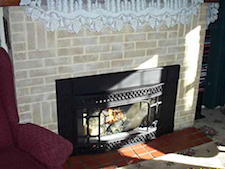 built-in classic brick fireplace