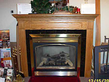 rich wood surround mantel fireplace